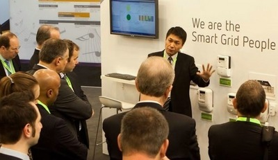 Software engineer of smart metering software company NES, gives a demonstration at OSGP tradefair booth.