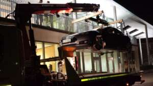 Tesla Model 3 hoisted to venue for roadshow Citrix Mobility